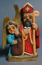 St Nicholas in red with angel and large bag