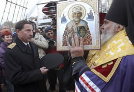 Archbishop giving icon to ship captain